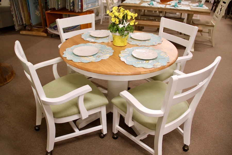 round table and caster chairs