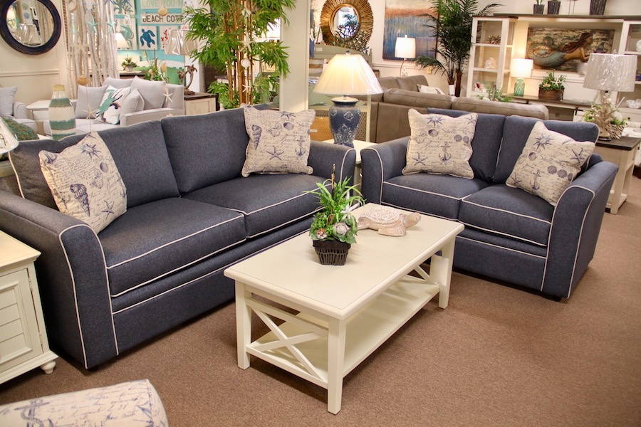 blue sofa and loveseat with contrasting welt
