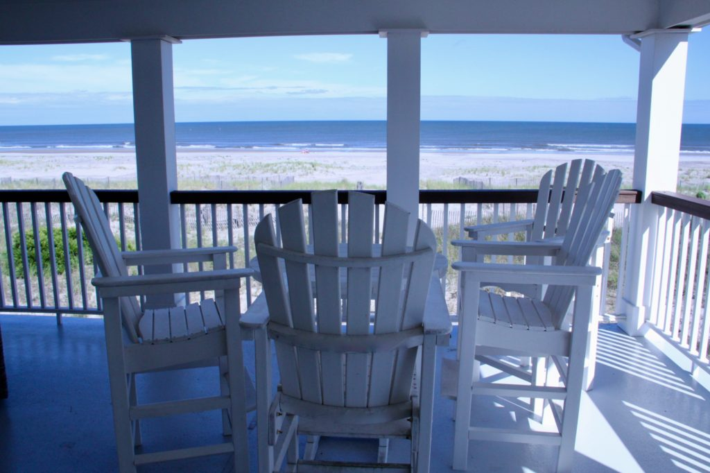 barstools on deck at beach